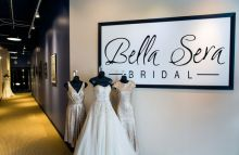 The long hall entrance that leads to the second-floor showroom is lined with notes and photos hanging on the walls from brides over the years. Gowns in photo: Sorella Vita on both ends and Justin Alexander in the middle. Photo ©Shawn Black Photography