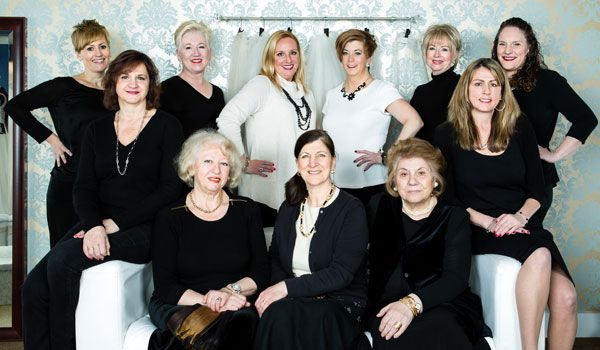 The Bella Sera Bridal & Occasion team (Top, L to R): Andrea Pepe, Sheryl Gould, Lisa Almeida (Owner), Heidi Nicholson (Owner), Lyne Lepone, Annie Almeida. (On couch, L to R): Deb Dolce, Slava Fookson, Gina Maniscalco, Maria Guarino, Deb Bejzian. Photo © Shawn Black Photography