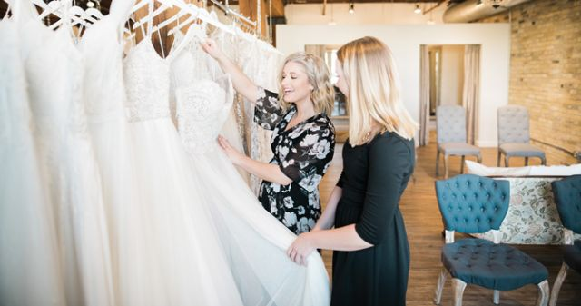 Sales Manager Sara & Stylist/Social Media & Marketing Coordinator Kylie training on new bridal collections.