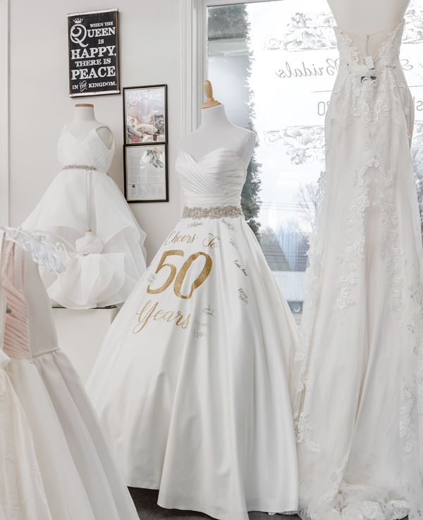 A 50th anniversary dress greets brides and 