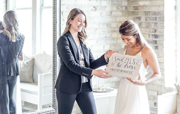 Bridal Stylist, Kylie, assisting a bride after she said yes to the dress.