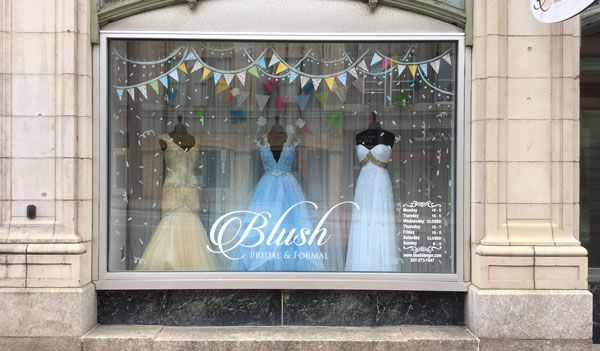 Blush Bridal and Formal in Bangor, Maine, focuses on incorporating playful props to create stories in window displays. Recently to kick off summer, the store cut up a pool noodle to create popsicles and ice cream cones.