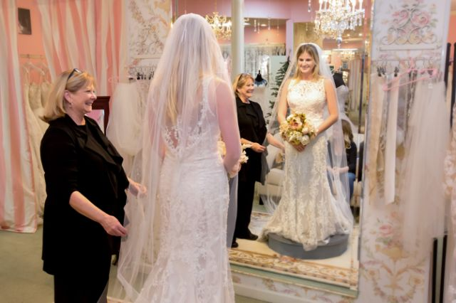 Paula Roberts, bridal consultant at The Bridal Suite of Louisville, helping a bride.