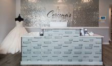 The shimmering wall of sequins behind the checkout desk at Coreena's Bridal Boutique sees brides off with some glamour.