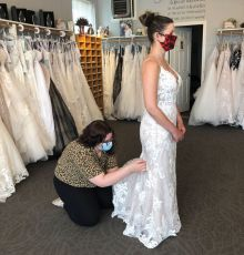Staff members and brides wearing masks became commonplace this spring. The practice is likely to stick at many bridal shops around the U.S. until a vaccine for COVID-19 becomes readily available. (Courtesy of Country Bridals & Formal Wear)