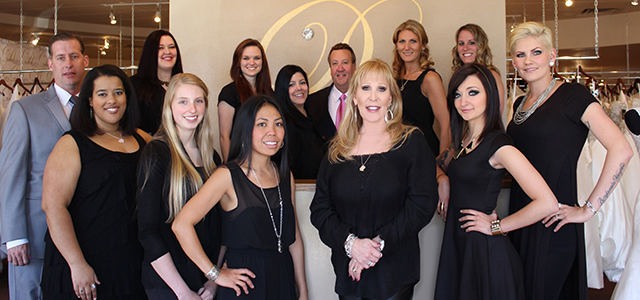 The Danelle's Bridal Boutique & Tuxedo Junction staff (Top, L to R): Jessica Tuerck, Shelby Dawson, Lorena Dodd, Ron Meyerle, Kali Shaw, Lindsay Bormet. (Bottom, L to R): Chris Martin, Sarah Steinmeier, Bethany Puskas, Cecil Horlbeck, Danelle Meyerle, Rebeka Cardinale, Sadie Hurd.