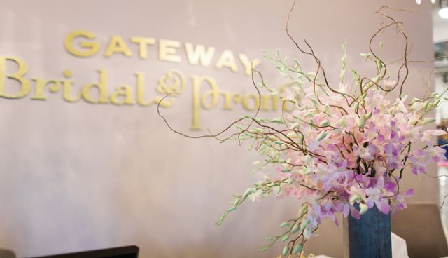 Having a statement floral piece in the reception area is a must for Gateway Bridal and Prom in Salt Lake City. Fresh-cut flowers are eye-catching and fill the salon with a subtle floral fragrance. Photo credit: Abby Khyl