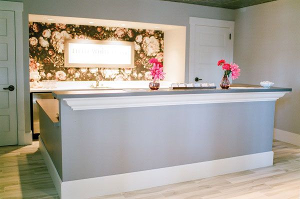 The reception desk in the store's entryway, 