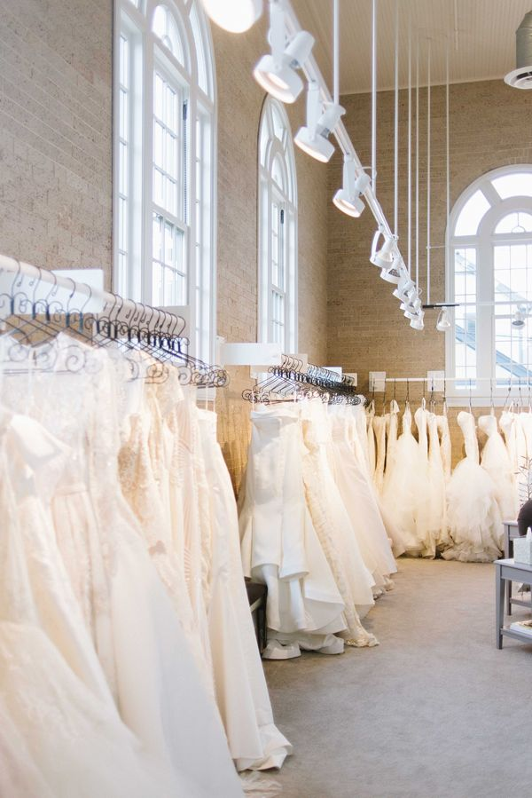 Rack lighting adds to the visual appeal of gowns at Little White Dress Bridal Shop in Denver