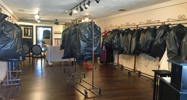 To minimize damage from Hurricane Irma, Ashley Sipos, owner of Lola Grace in Daytona Beach, Fla., placed dresses in garment bags, folded them in half, hung them from high racks and then placed them inside giant contractor bags.