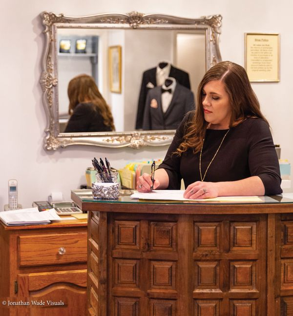 Michelle filling out bridal paperwork at the front of the shop.