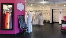 The Bridal Collection in Centennial, Colo., awaits eager brides, while a chalkboard sign relays important sale rules and other information to guests.