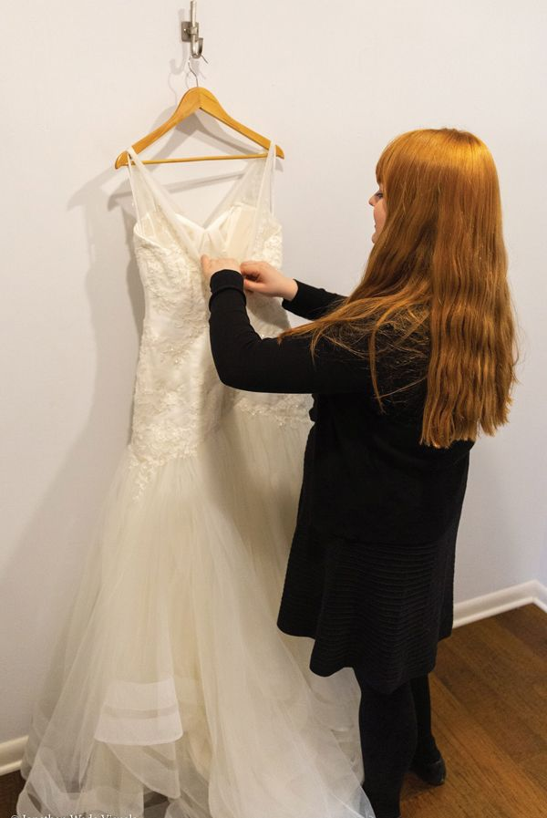 Riley putting up wedding gowns.