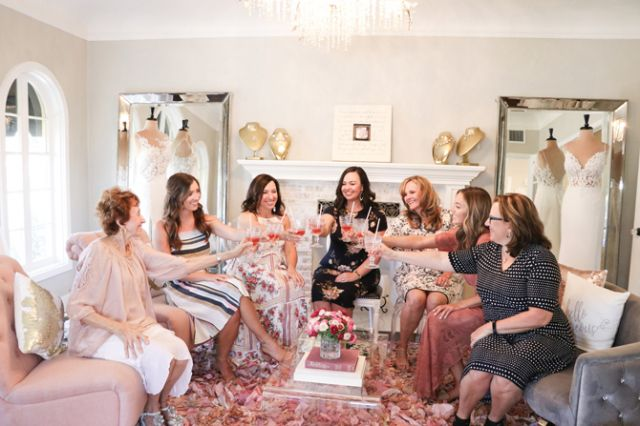 Parlors have long been used for family occasions, including weddings, and Uptown Bridal & Boutique's sitting parlor allows a bride and her guests to gather in a cozy space before the beginning of the group's private appointment.