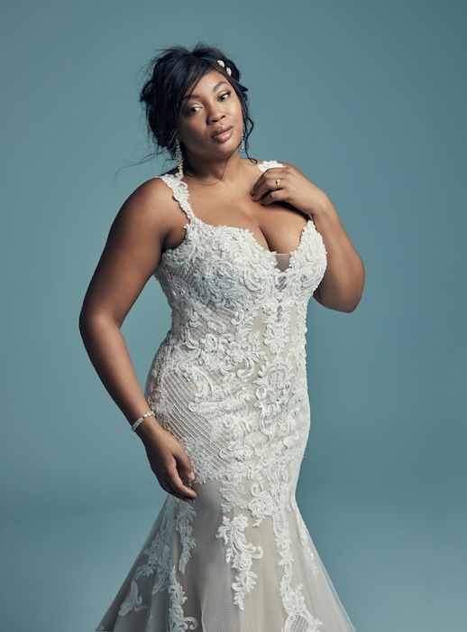 A featured gown in Maggie Sottero's new Curves collection showcases the modern, sexy styling of the collection.