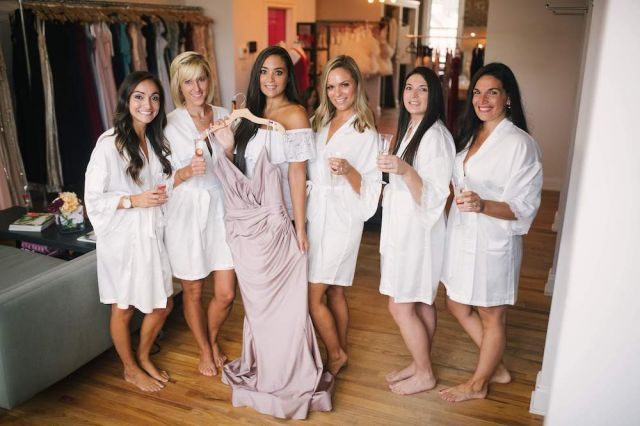 Samantha Giancola (@sammisweetheart)  (center) poses In Bella Bridesmaids Freehold with her bridesmaids and the Bari Jay Luxe dress she fell in love with.